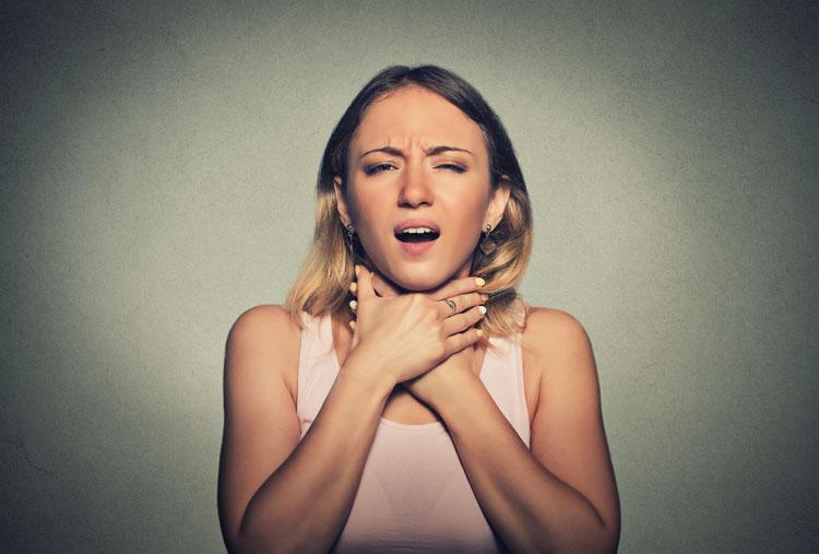 woman clutching throat