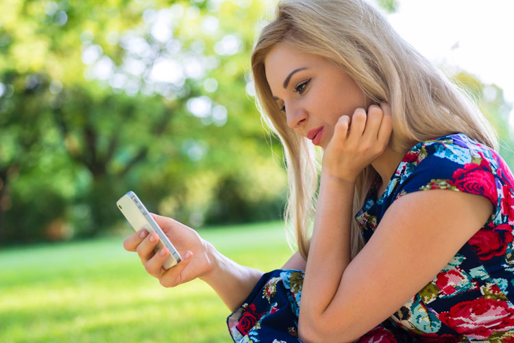 woman on smartphone in park